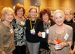 Photo of a group of women smiling. Link to Life Stage Gift Planner Ages 60-70 Situations.